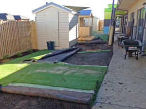 Synthetic Grass Melbourne - Repairing damaged base work & grass due to storm water pipe rupture