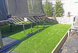 Residential Back Yard - Synthetic Grass Lay Installed 6 months earlier - Happy Customer!