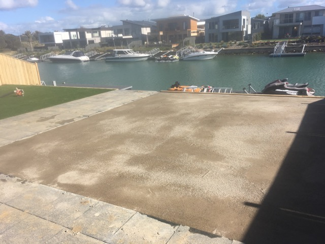 Peninsula Synthetic Grass - base work complete and grass being laid in Martha Cove, Safety Beach